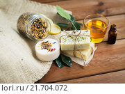 Купить «close up of handmade soap bars on wood», фото № 21704072, снято 21 декабря 2015 г. (c) Syda Productions / Фотобанк Лори