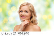 Купить «smiling woman with bare shoulders touching face», фото № 21704940, снято 27 ноября 2015 г. (c) Syda Productions / Фотобанк Лори