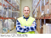 Купить «happy man in reflective safety vest at warehouse», фото № 21705676, снято 9 декабря 2015 г. (c) Syda Productions / Фотобанк Лори