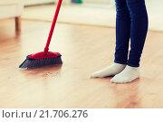 Купить «close up of woman legs with broom sweeping floor», фото № 21706276, снято 18 февраля 2015 г. (c) Syda Productions / Фотобанк Лори