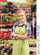 Купить «happy woman with flowers in greenhouse», фото № 21706524, снято 25 февраля 2015 г. (c) Syda Productions / Фотобанк Лори