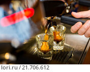 Купить «close up of woman doing espresso by coffee machine», фото № 21706612, снято 1 декабря 2015 г. (c) Syda Productions / Фотобанк Лори