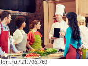 Купить «happy friends with chef and tablet pc in kitchen», фото № 21706760, снято 12 февраля 2015 г. (c) Syda Productions / Фотобанк Лори