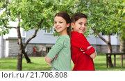 Купить «happy boy and girl standing together over backyard», фото № 21706808, снято 9 января 2016 г. (c) Syda Productions / Фотобанк Лори