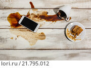 Купить «Cup of coffee spilled on wooden table», фото № 21795012, снято 24 марта 2019 г. (c) PantherMedia / Фотобанк Лори