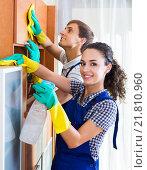 Купить «Couple in uniform cleaning indoors», фото № 21810960, снято 9 декабря 2017 г. (c) Яков Филимонов / Фотобанк Лори