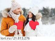 Купить «happy couple with red hearts over winter landscape», фото № 21813276, снято 23 января 2016 г. (c) Syda Productions / Фотобанк Лори