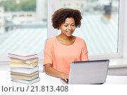 Купить «happy african american woman with laptop at home», фото № 21813408, снято 8 июля 2015 г. (c) Syda Productions / Фотобанк Лори