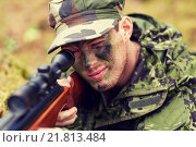 Купить «soldier or hunter shooting with gun in forest», фото № 21813484, снято 14 августа 2014 г. (c) Syda Productions / Фотобанк Лори