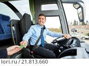 Купить «bus driver taking ticket or card from passenger», фото № 21813660, снято 21 октября 2015 г. (c) Syda Productions / Фотобанк Лори