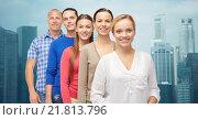 Купить «group of smiling people over city buildings», фото № 21813796, снято 21 октября 2015 г. (c) Syda Productions / Фотобанк Лори