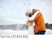 Купить «happy couple hugging and laughing in winter», фото № 21813932, снято 23 января 2016 г. (c) Syda Productions / Фотобанк Лори