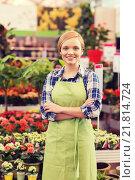Купить «happy woman with flowers in greenhouse», фото № 21814724, снято 25 февраля 2015 г. (c) Syda Productions / Фотобанк Лори