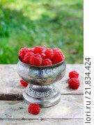 Купить «Raspberries in vintage silver goblet. Healthy food», фото № 21834424, снято 20 ноября 2018 г. (c) BE&W Photo / Фотобанк Лори
