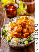 Купить «Chicken curry with basmati rice and green peas, dish popular in India.», фото № 21834472, снято 15 октября 2019 г. (c) BE&W Photo / Фотобанк Лори