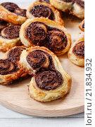 Купить «Palmier biscuits - french cookies made of puff pastry and chocolate», фото № 21834932, снято 22 октября 2018 г. (c) BE&W Photo / Фотобанк Лори