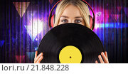 Купить «Composite image of portrait of a beautiful woman holding a vinyl», фото № 21848228, снято 12 декабря 2018 г. (c) Wavebreak Media / Фотобанк Лори