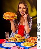 Купить «Girl eating big sandwich.», фото № 21857024, снято 15 октября 2015 г. (c) Gennadiy Poznyakov / Фотобанк Лори