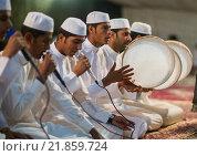 Купить «Iran, Qeshm Island, Tabl , men singing and playing music during a wedding ceremony.», фото № 21859724, снято 22 декабря 2015 г. (c) age Fotostock / Фотобанк Лори
