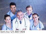 Купить «Portrait of medical team standing with arms crossed», фото № 21887904, снято 18 октября 2015 г. (c) Wavebreak Media / Фотобанк Лори