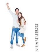 Купить «Triumphant couple raising fist», фото № 21888332, снято 7 октября 2015 г. (c) Wavebreak Media / Фотобанк Лори