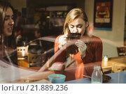 Купить «Friends chatting over coffee», фото № 21889236, снято 30 сентября 2015 г. (c) Wavebreak Media / Фотобанк Лори