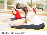 Купить «pregnant woman with instructor doing fitness ball exercise», фото № 21893264, снято 3 ноября 2015 г. (c) Дмитрий Калиновский / Фотобанк Лори