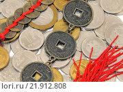 Купить «Российские деньги и китайские монеты, фэн-шуй», эксклюзивное фото № 21912808, снято 20 февраля 2016 г. (c) Юрий Морозов / Фотобанк Лори