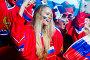 Smiling woman in stadium, фото № 21921820, снято 15 декабря 2015 г. (c) Raev Denis / Фотобанк Лори