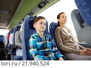 Купить «happy family riding in travel bus», фото № 21940524, снято 21 октября 2015 г. (c) Syda Productions / Фотобанк Лори