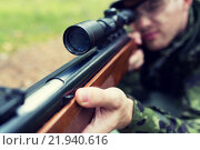 Купить «close up of soldier or hunter with gun in forest», фото № 21940616, снято 14 августа 2014 г. (c) Syda Productions / Фотобанк Лори