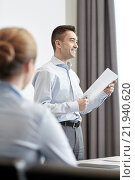 Купить «smiling businesspeople meeting in office», фото № 21940620, снято 25 октября 2014 г. (c) Syda Productions / Фотобанк Лори