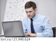 Купить «businessman sitting with laptop in office», фото № 21940624, снято 25 октября 2014 г. (c) Syda Productions / Фотобанк Лори