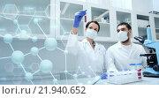 Купить «young scientists making test or research in lab», фото № 21940652, снято 4 декабря 2014 г. (c) Syda Productions / Фотобанк Лори
