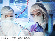 Купить «close up of scientists making test in chemical lab», фото № 21940656, снято 4 декабря 2014 г. (c) Syda Productions / Фотобанк Лори