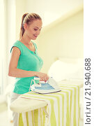Купить «happy woman with iron and ironing board at home», фото № 21940688, снято 25 января 2015 г. (c) Syda Productions / Фотобанк Лори