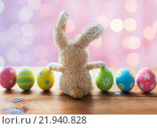 Купить «close up of colored easter eggs and bunny», фото № 21940828, снято 27 января 2016 г. (c) Syda Productions / Фотобанк Лори