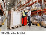 Купить «worker on forklift and businessman at warehouse», фото № 21940852, снято 9 декабря 2015 г. (c) Syda Productions / Фотобанк Лори