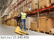 Купить «man with loader and clipboard at warehouse», фото № 21940856, снято 9 декабря 2015 г. (c) Syda Productions / Фотобанк Лори