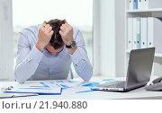 Купить «stressed businessman with papers in office», фото № 21940880, снято 18 июня 2015 г. (c) Syda Productions / Фотобанк Лори