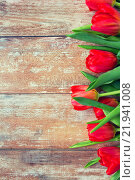 Купить «close up of red tulips on wooden background», фото № 21941008, снято 3 марта 2015 г. (c) Syda Productions / Фотобанк Лори