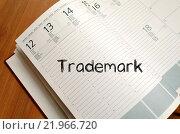 Купить «Trademark write on notebook», фото № 21966720, снято 22 марта 2019 г. (c) PantherMedia / Фотобанк Лори
