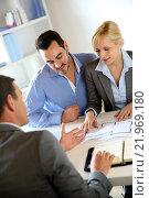 Купить «Couple meeting real-estate agent to buy property», фото № 21969180, снято 16 июня 2019 г. (c) PantherMedia / Фотобанк Лори