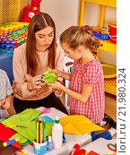Купить «Group kids holding origami airplane in kindergarten .», фото № 21980324, снято 4 октября 2015 г. (c) Gennadiy Poznyakov / Фотобанк Лори