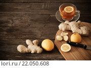 Купить «cup of ginger tea on a wooden table», фото № 22050608, снято 21 февраля 2016 г. (c) Майя Крученкова / Фотобанк Лори