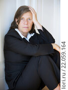 Купить «businesswoman sitting depressed in corner», фото № 22059164, снято 21 сентября 2018 г. (c) PantherMedia / Фотобанк Лори