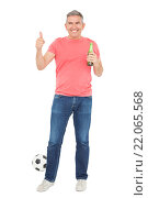 Купить «Handsome football fan drinking beer», фото № 22065568, снято 7 октября 2015 г. (c) Wavebreak Media / Фотобанк Лори