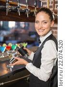 Купить «Barmaid pouring cocktail», фото № 22074520, снято 24 октября 2015 г. (c) Wavebreak Media / Фотобанк Лори