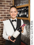 Купить «Barmaid holding a wine bottle», фото № 22074556, снято 24 октября 2015 г. (c) Wavebreak Media / Фотобанк Лори