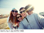 Купить «group of happy friends taking selfie on street», фото № 22079140, снято 19 марта 2015 г. (c) Syda Productions / Фотобанк Лори